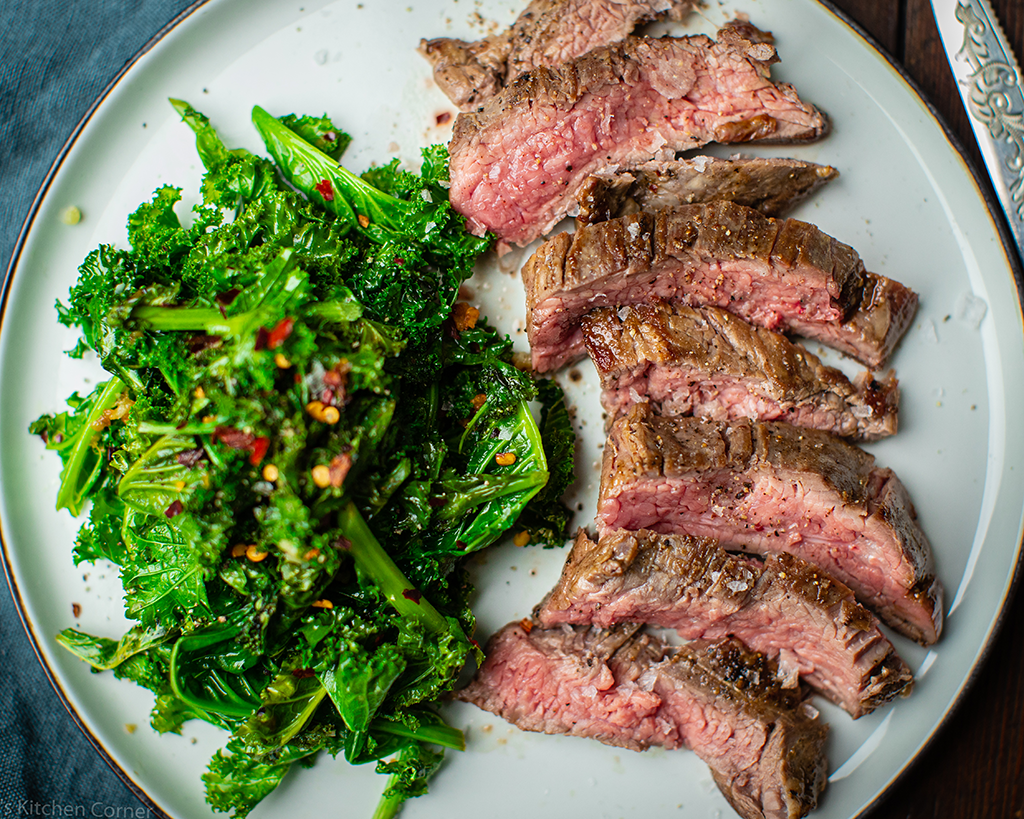 Bavette steak with garlic and chilli kale