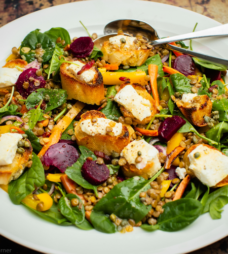 Beetroot, green lentil and spinach salad with bacon lardons and goat's cheese croûte