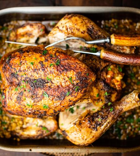 Spicy roast chicken with Greek stuffing & freekeh